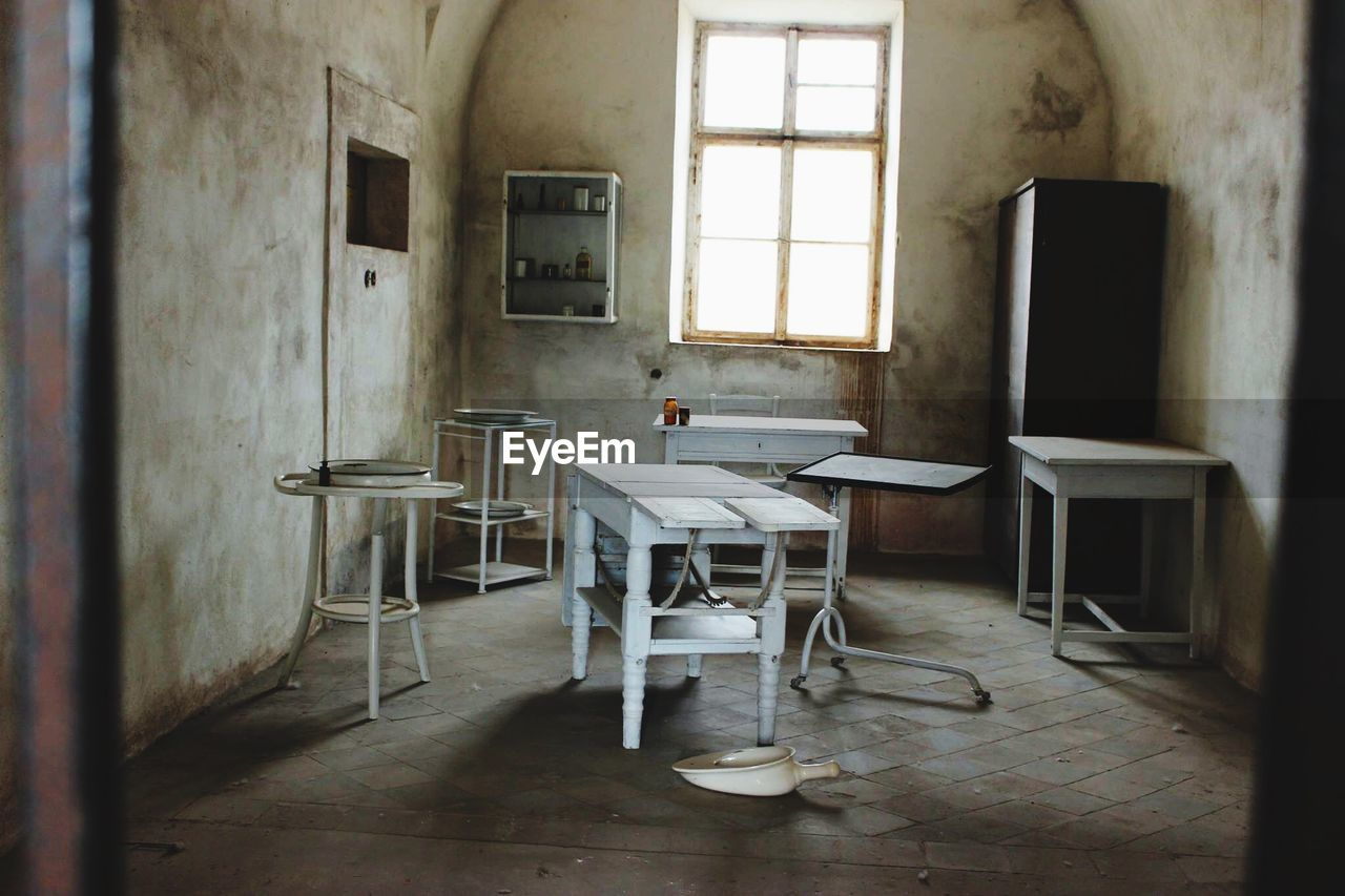 Empty Chairs And Table In Abandoned Room