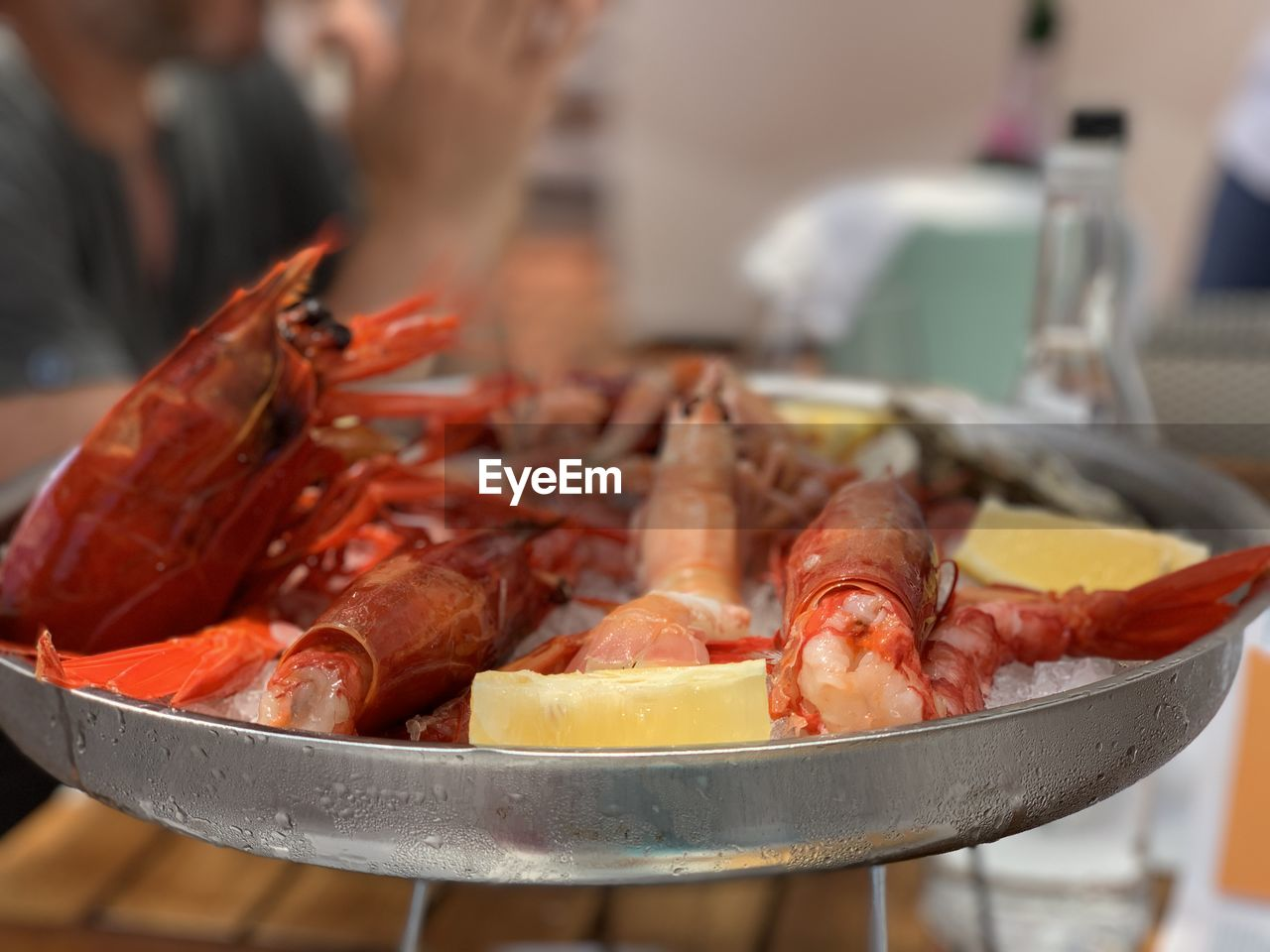 food and drink, food, freshness, seafood, focus on foreground, crustacean, close-up, indoors, healthy eating, wellbeing, incidental people, real people, still life, table, human body part, one person, selective focus, raw food, crab, preparing food