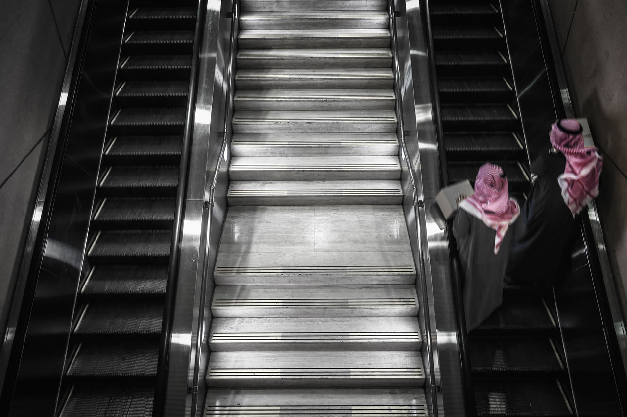 High Angle View Of People Moving Up On Escalator