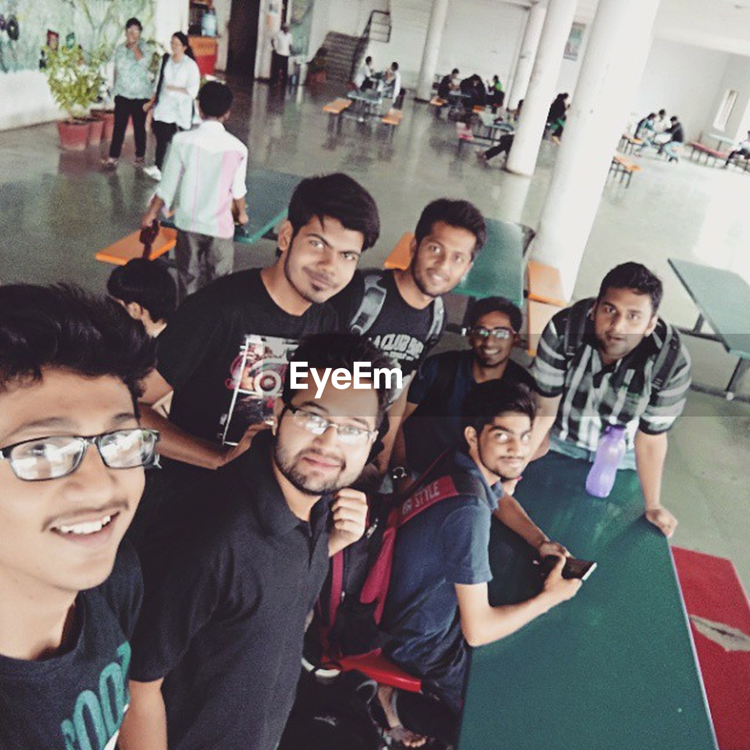 togetherness, lifestyles, leisure activity, bonding, friendship, person, young adult, young men, happiness, portrait, looking at camera, smiling, casual clothing, love, front view, indoors, enjoyment, fun