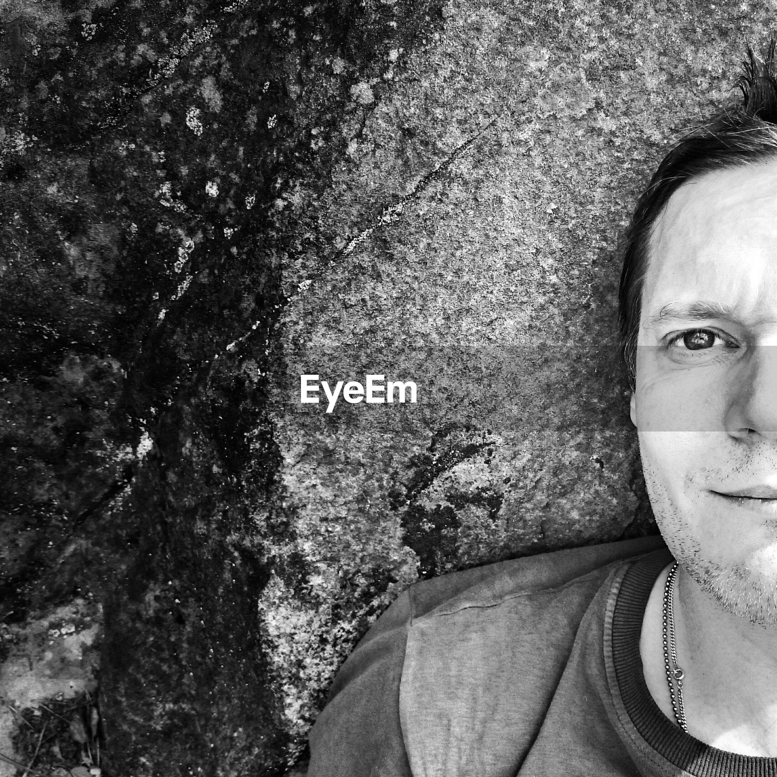 Close-up high angle portrait of man lying on land
