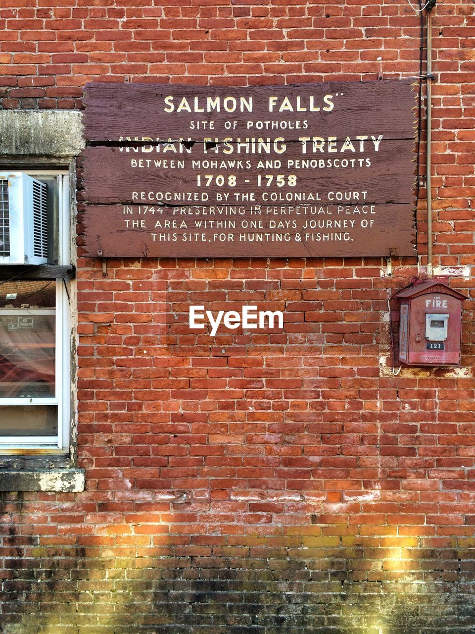 architecture, brick, built structure, brick wall, wall, text, communication, building exterior, western script, wall - building feature, no people, sign, building, information, day, window, outdoors, information sign, low angle view, red, message
