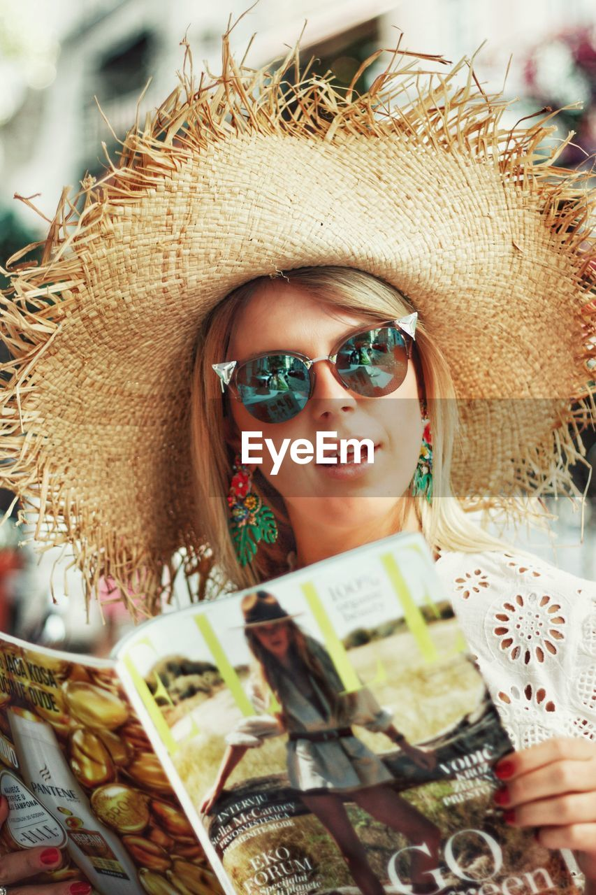 real people, lifestyles, one person, glasses, leisure activity, headshot, portrait, hat, women, front view, sunglasses, smiling, adult, young women, young adult, fashion, day, emotion, outdoors, hairstyle, beautiful woman