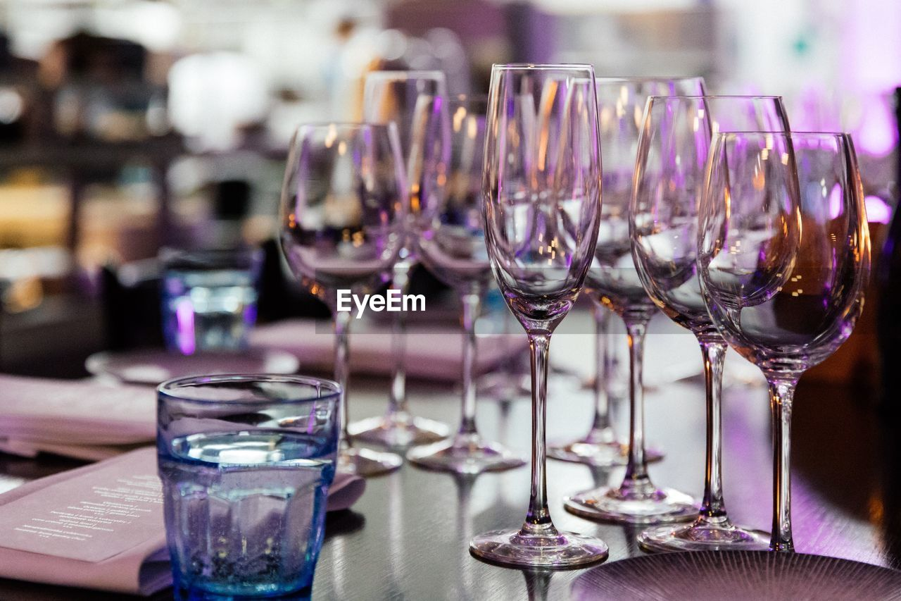 CLOSE-UP OF WINE IN GLASSES ON TABLE