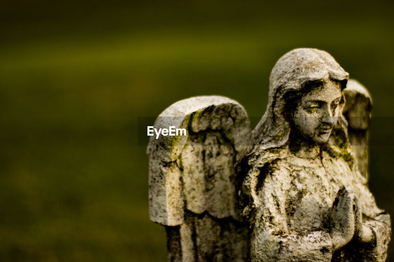 sculpture, statue, no people, art and craft, human representation, representation, focus on foreground, creativity, old, cemetery, male likeness, craft, grave, close-up, solid, stone, religion, day, the past, angel