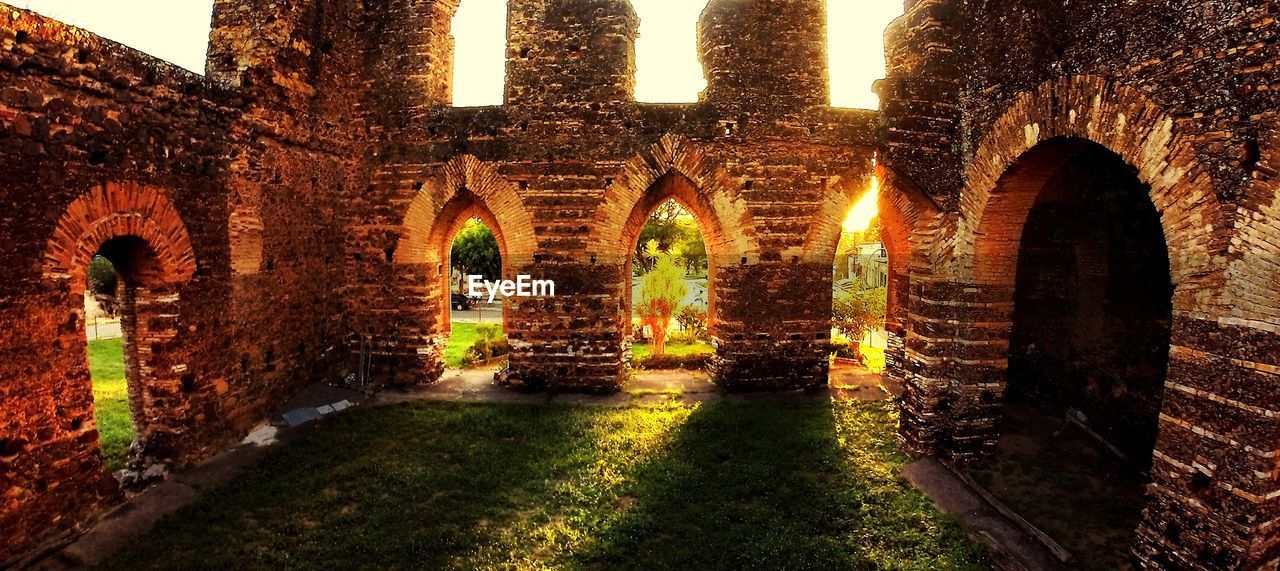 arch, built structure, architecture, history, illuminated, old ruin, building exterior, outdoors, night, no people, grass, nature