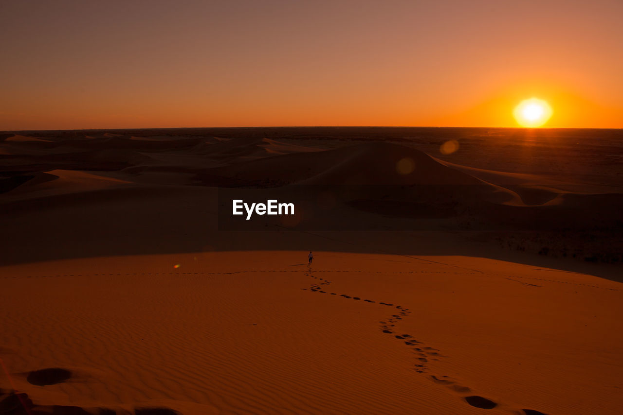 sunset, sky, land, beauty in nature, scenics - nature, sand, orange color, non-urban scene, tranquil scene, desert, sand dune, tranquility, nature, landscape, environment, arid climate, horizon, climate, no people, beach, sun, outdoors
