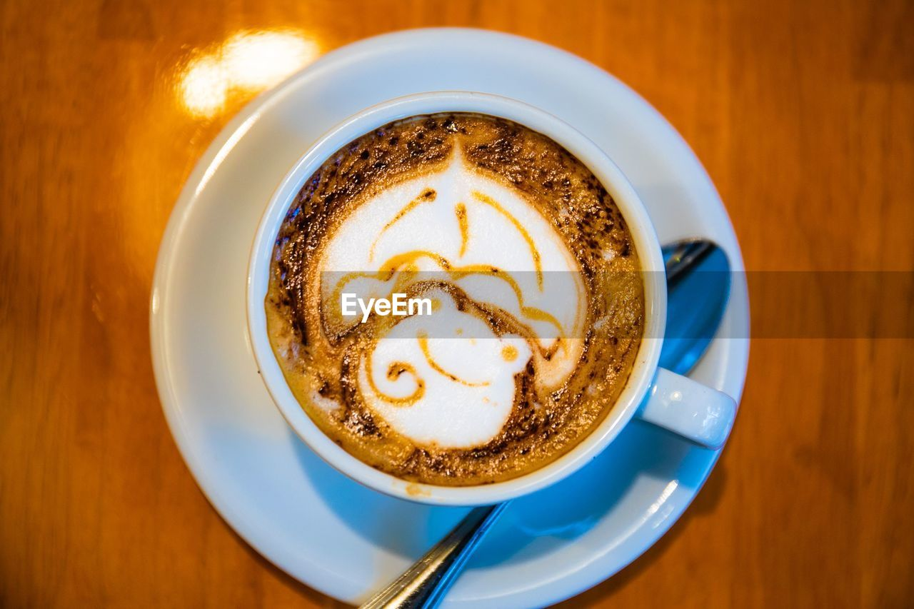 coffee, coffee - drink, cup, refreshment, drink, mug, coffee cup, food and drink, saucer, frothy drink, table, still life, froth art, eating utensil, kitchen utensil, indoors, spoon, hot drink, crockery, cappuccino, no people, latte, non-alcoholic beverage, froth