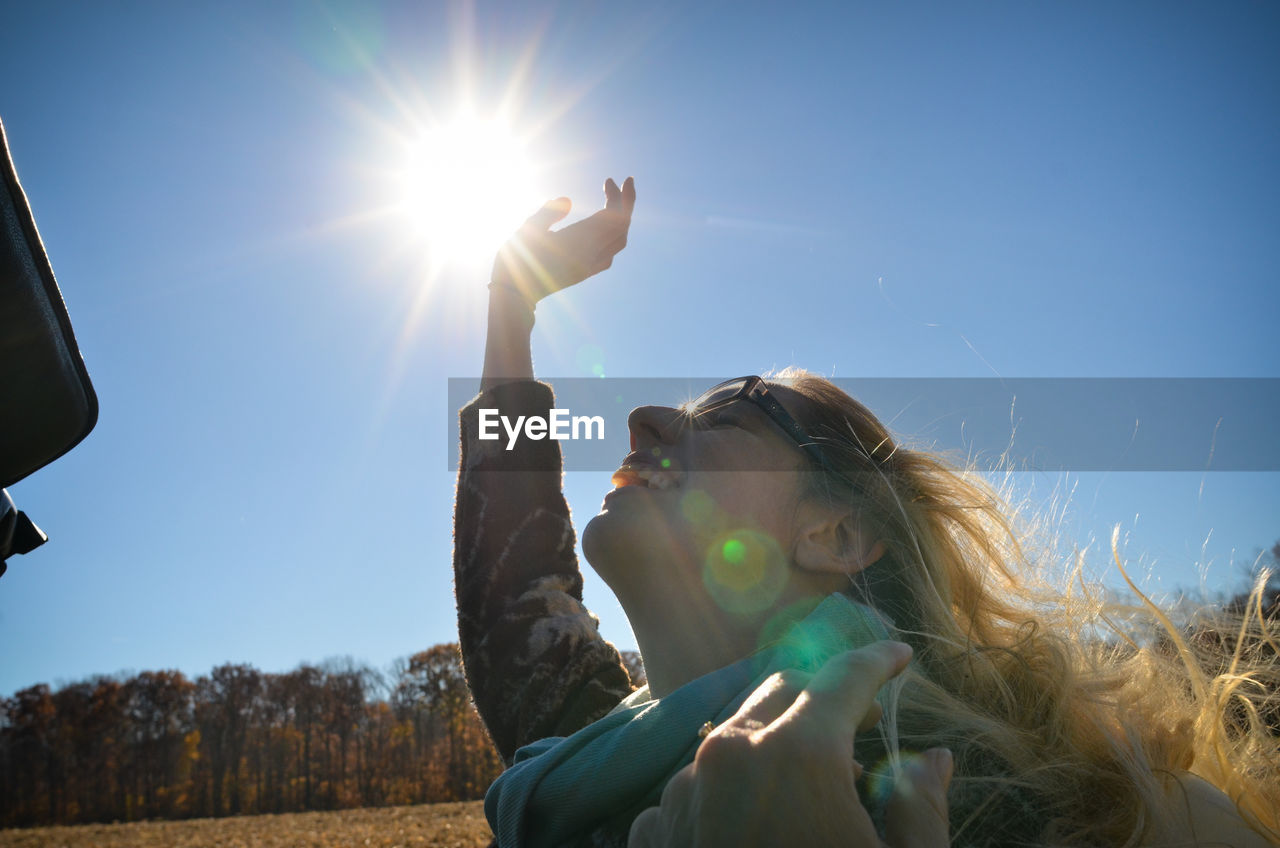 Smiling Woman Against Clear Blue Sky