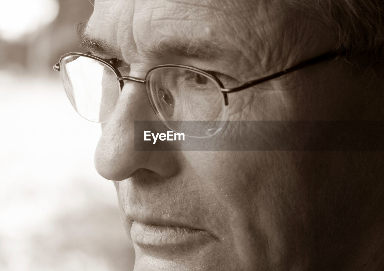 Close-Up Of Thoughtful Mature Man Wearing Eyeglasses