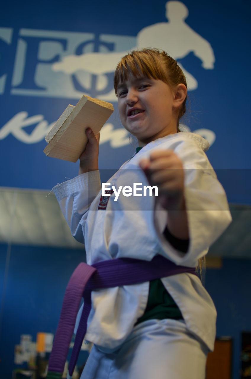 Girl  posing in martial arts uniform