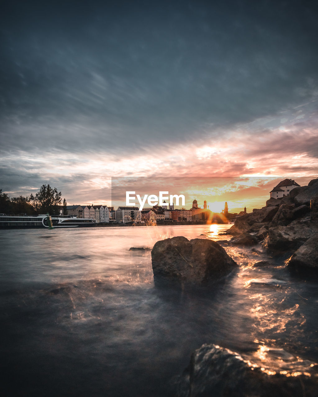 sky, water, cloud - sky, sunset, nature, beauty in nature, scenics - nature, sea, no people, waterfront, architecture, built structure, rock, idyllic, tranquility, motion, land, outdoors, tranquil scene