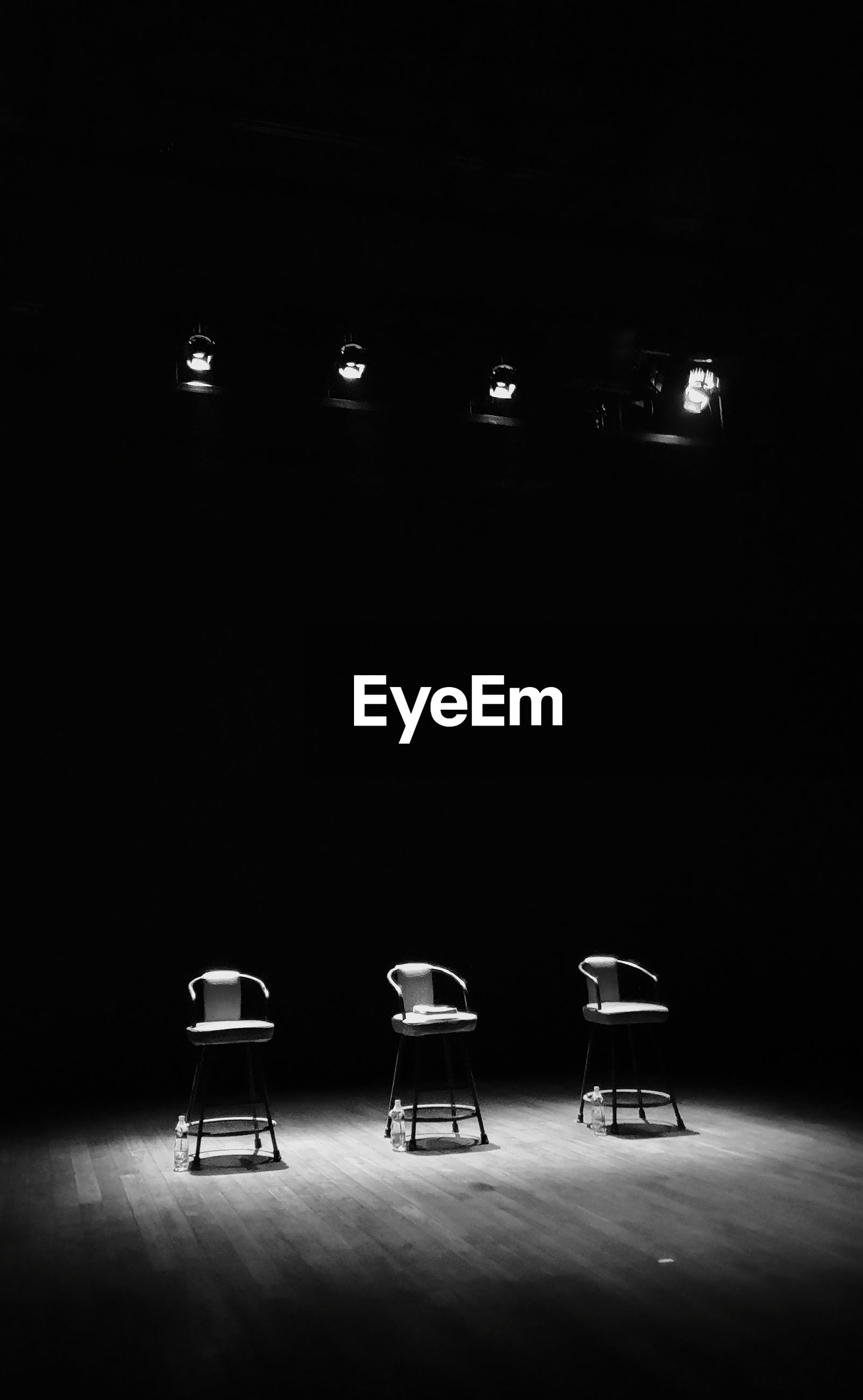 Empty chairs on stage