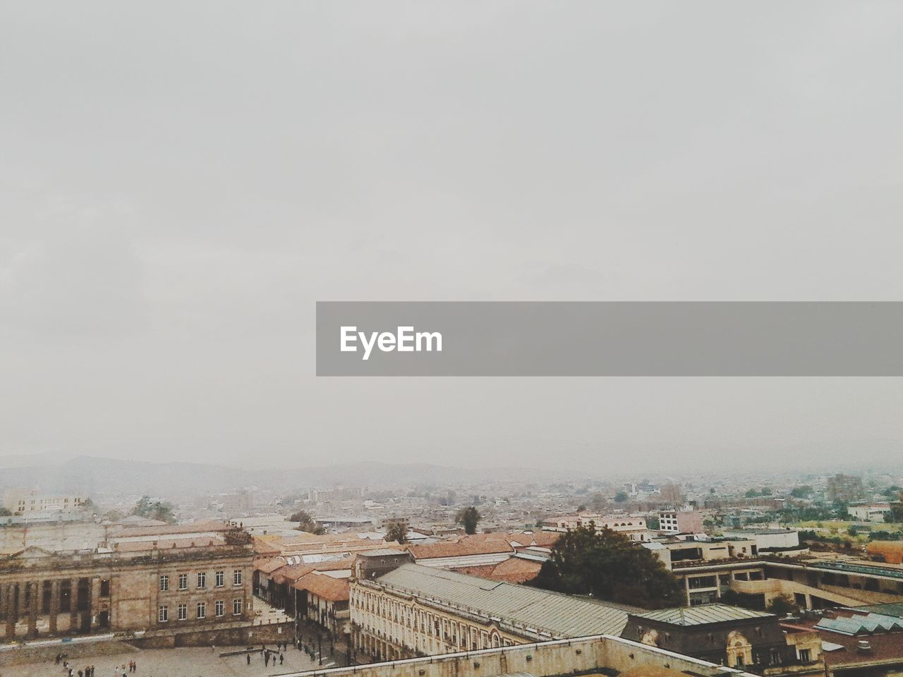 Aerial View Of City In Foggy Weather