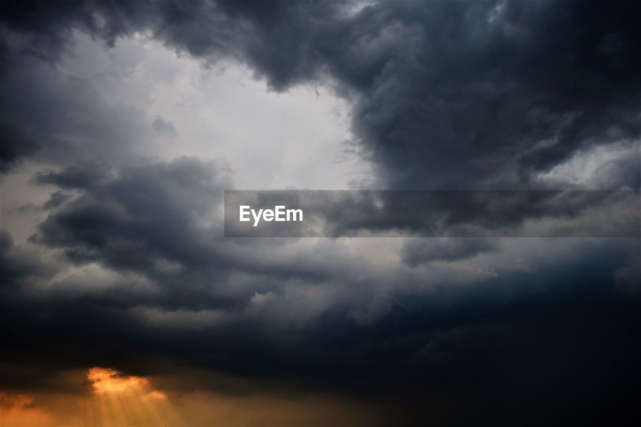 cloud - sky, sky, beauty in nature, tranquility, low angle view, scenics - nature, nature, no people, storm, tranquil scene, overcast, outdoors, storm cloud, cloudscape, dramatic sky, sunset, idyllic, backgrounds, day, ominous, meteorology