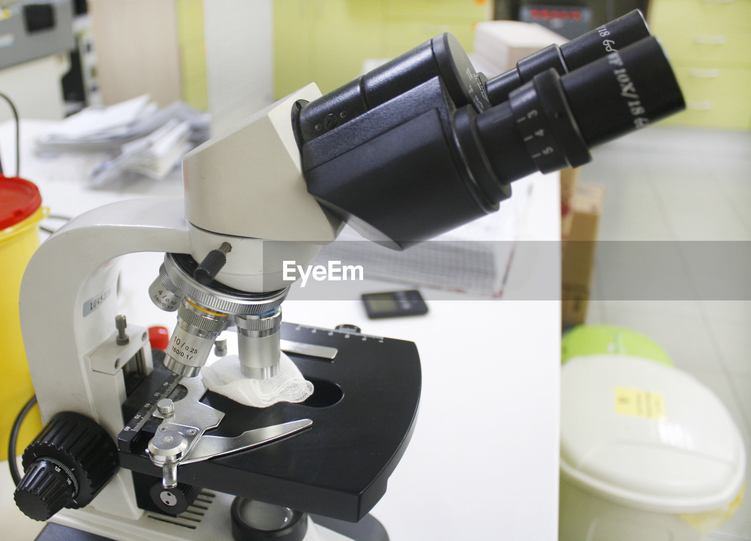 Close-up of microscope on table in laboratory