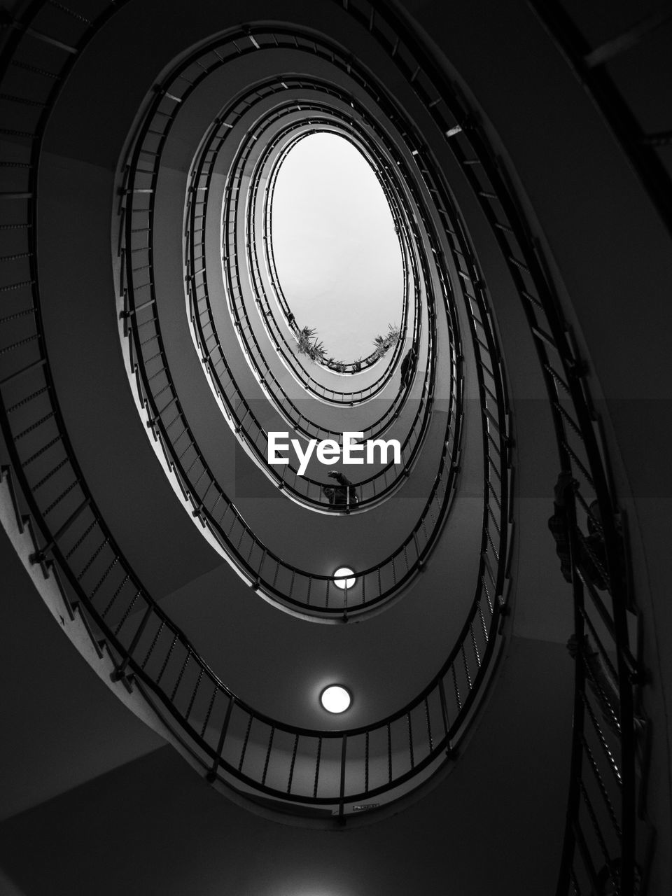 architecture, built structure, staircase, steps and staircases, low angle view, spiral, railing, directly below, spiral staircase, indoors, pattern, no people, geometric shape, shape, sky, building, design, day, nature, skylight, ceiling