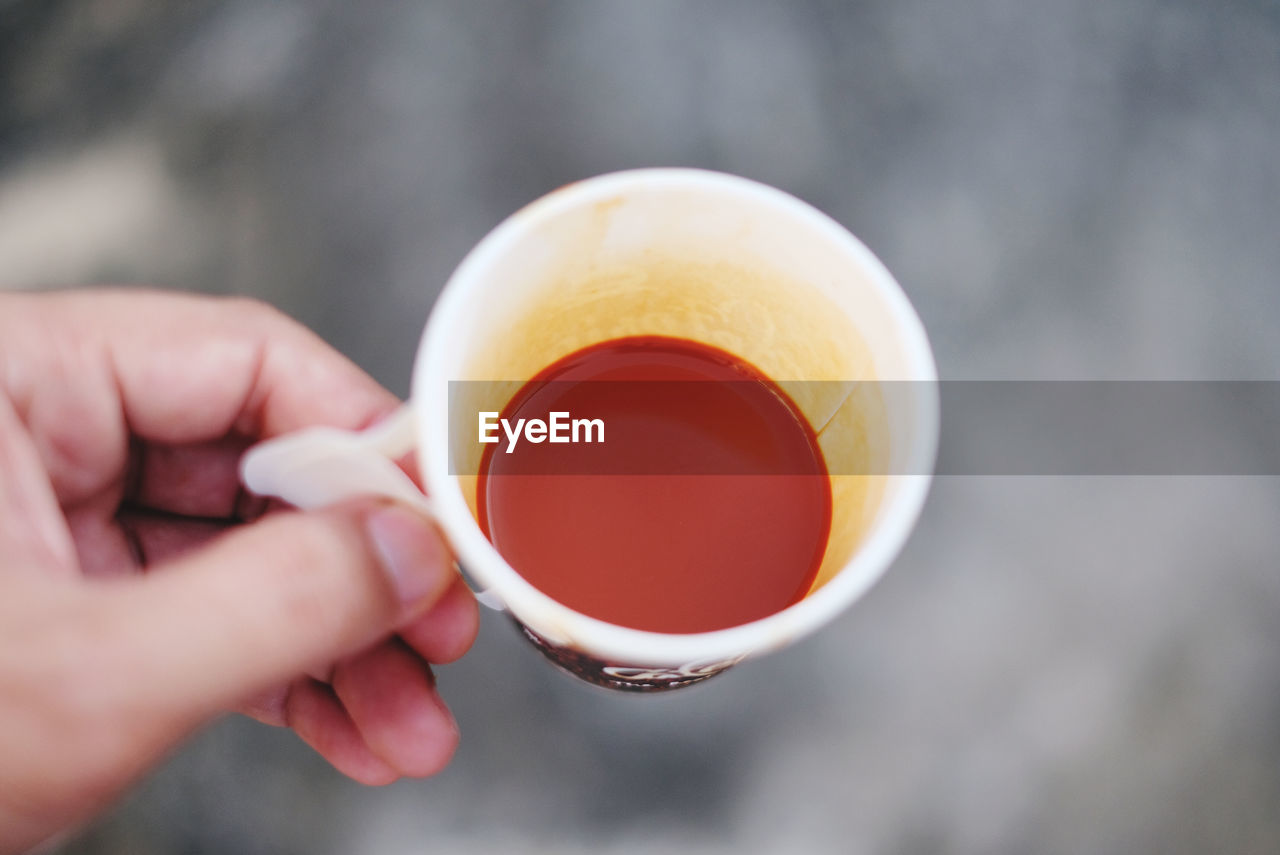 PERSON HOLDING TEA CUP