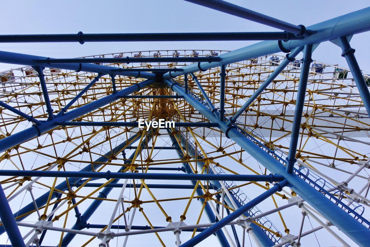 sky, metal, amusement park ride, amusement park, arts culture and entertainment, low angle view, day, ferris wheel, built structure, no people, nature, architecture, clear sky, leisure activity, blue, outdoors, fairground, fun, enjoyment, carnival, excitement