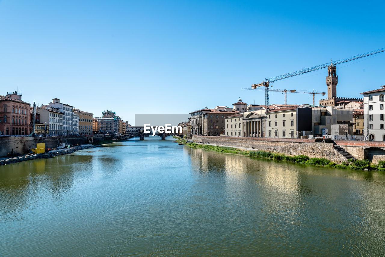 Ponte Vecchio Over Arno River Against Sky In City