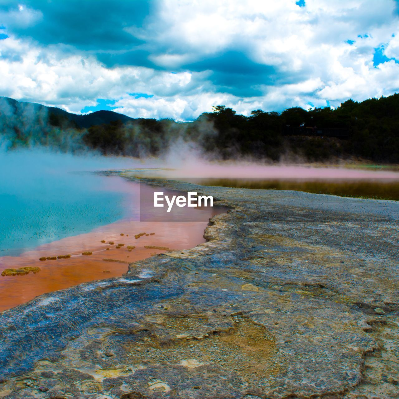geyser, water, hot spring, steam, nature, geology, outdoors, scenics, sky, beauty in nature, no people, day, tourism, physical geography, travel destinations, tranquility, cloud - sky, lake, landscape, mountain