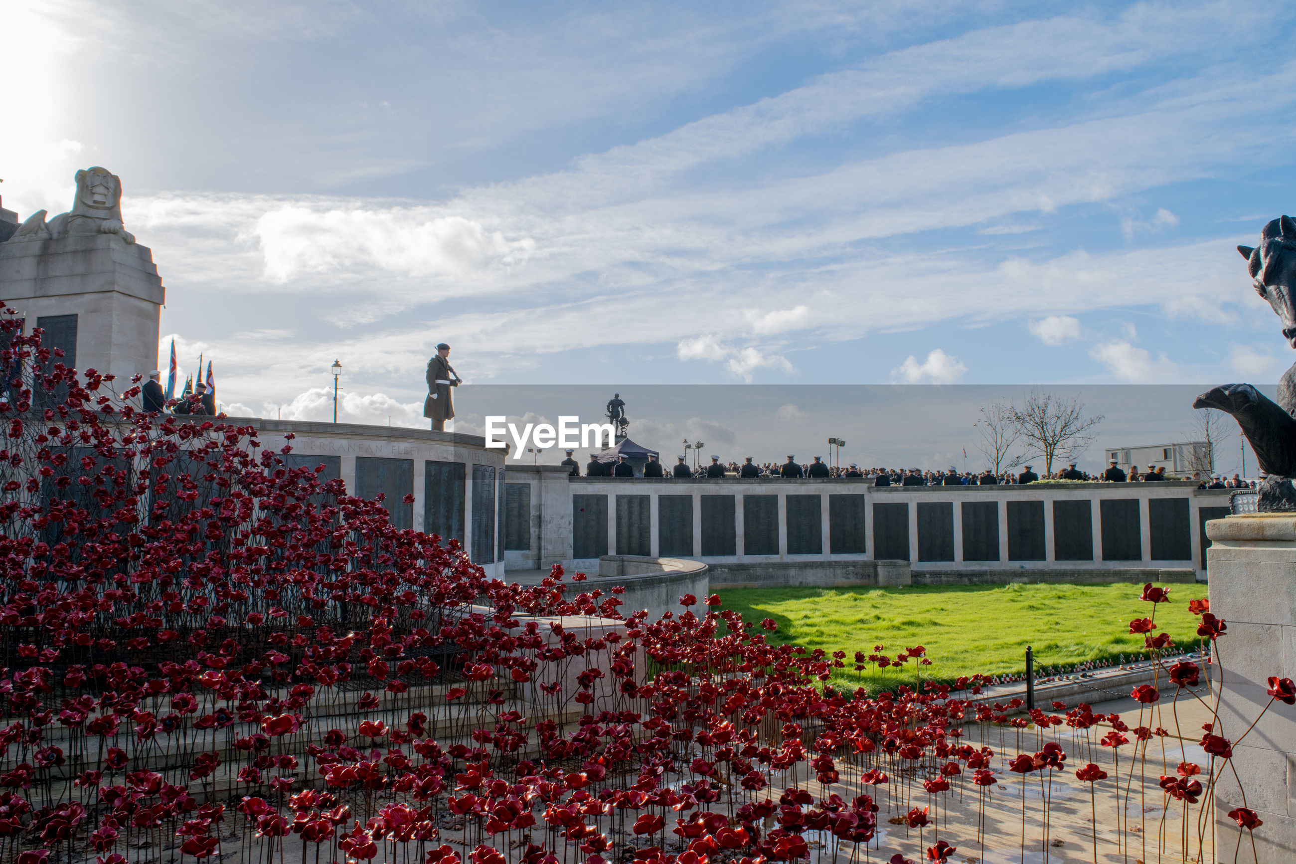 sky, built structure, architecture, cloud - sky, large group of people, outdoors, building exterior, history, day, travel destinations, real people, nature, tree, crowd, flower, people