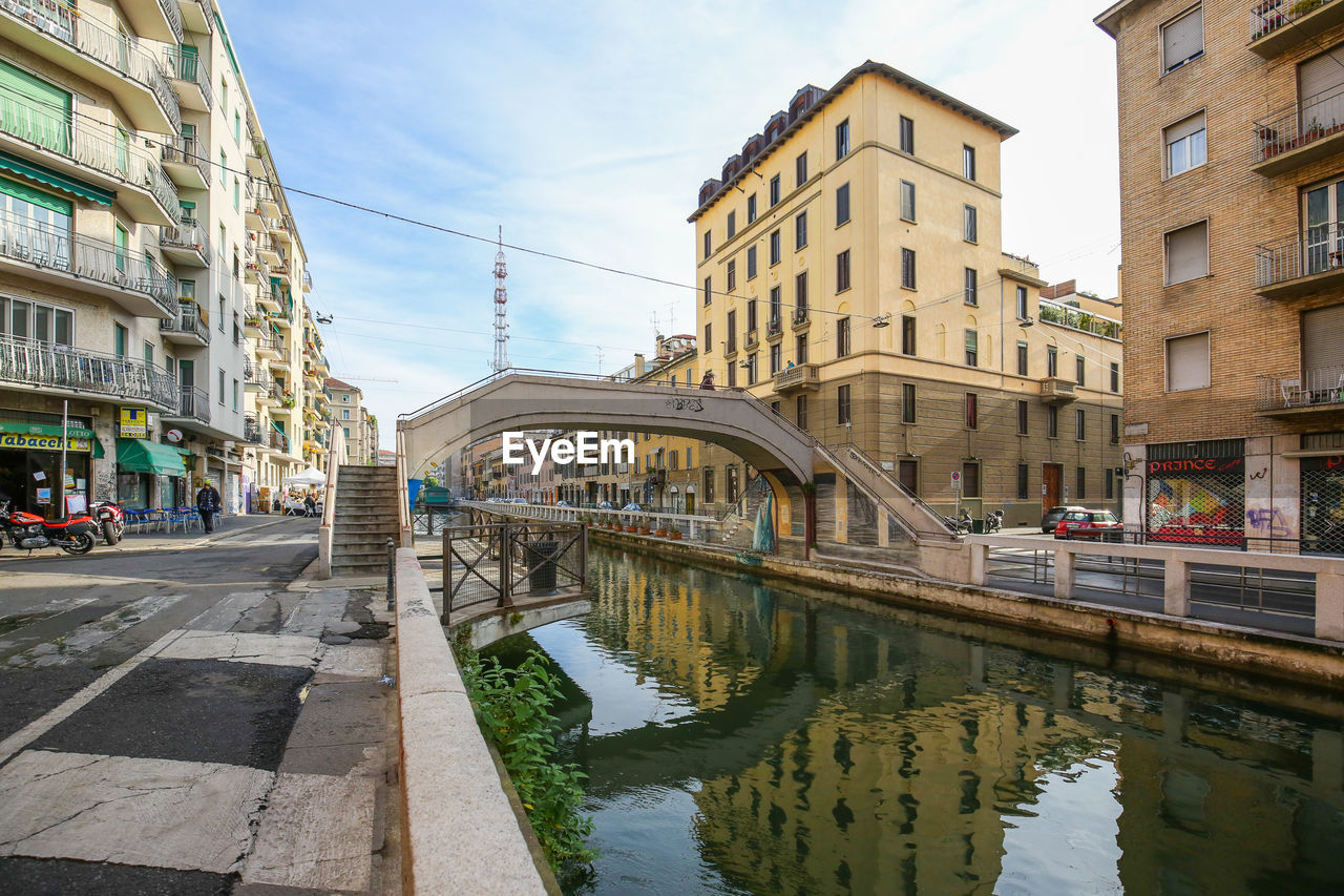 architecture, built structure, building exterior, reflection, incidental people, sky, city, water, transportation, day, connection, outdoors, bridge - man made structure, road