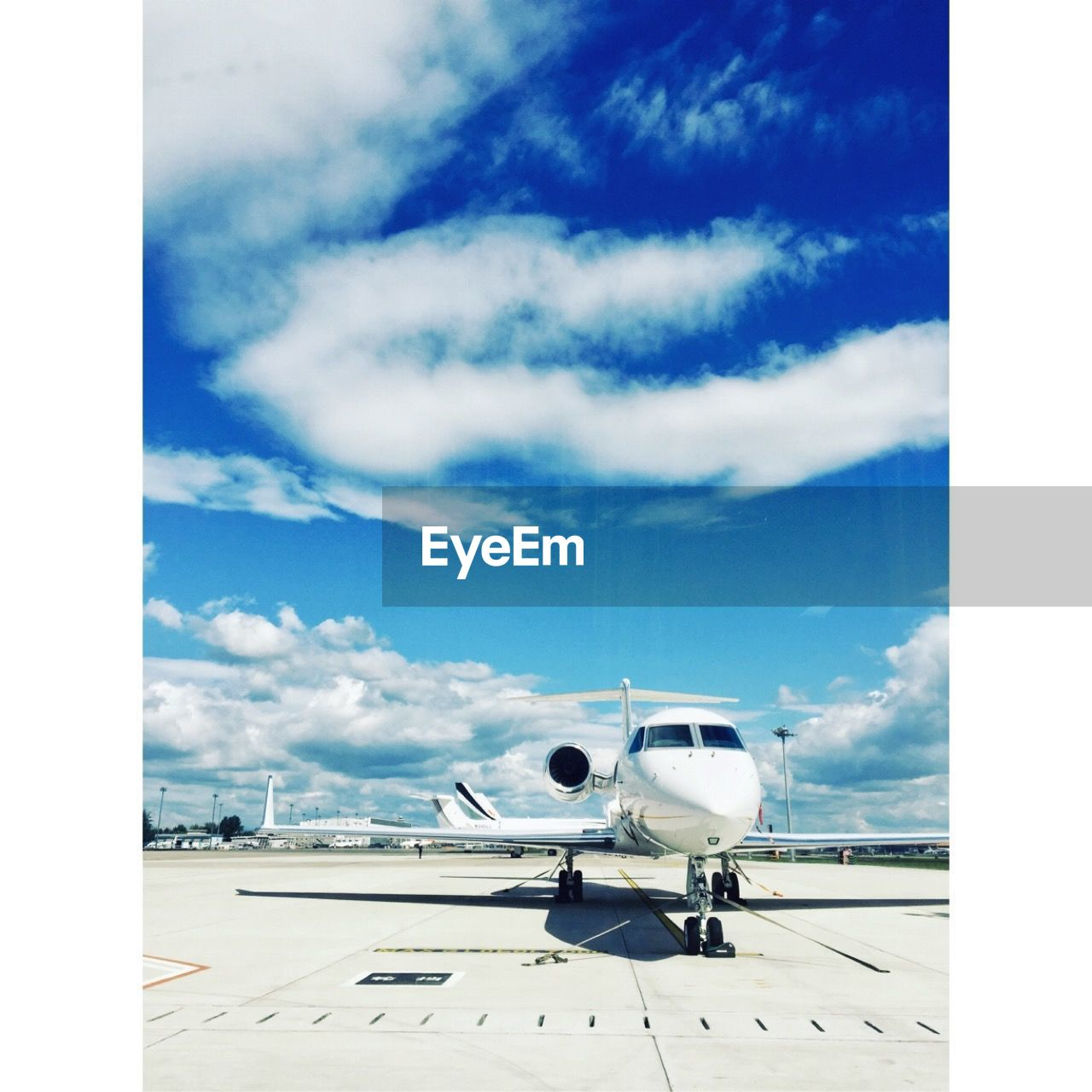 sky, cloud - sky, airport, transportation, mode of transportation, air vehicle, airplane, nature, travel, day, airport runway, blue, no people, outdoors, public transportation, runway, sunlight, commercial airplane, journey, aerospace industry