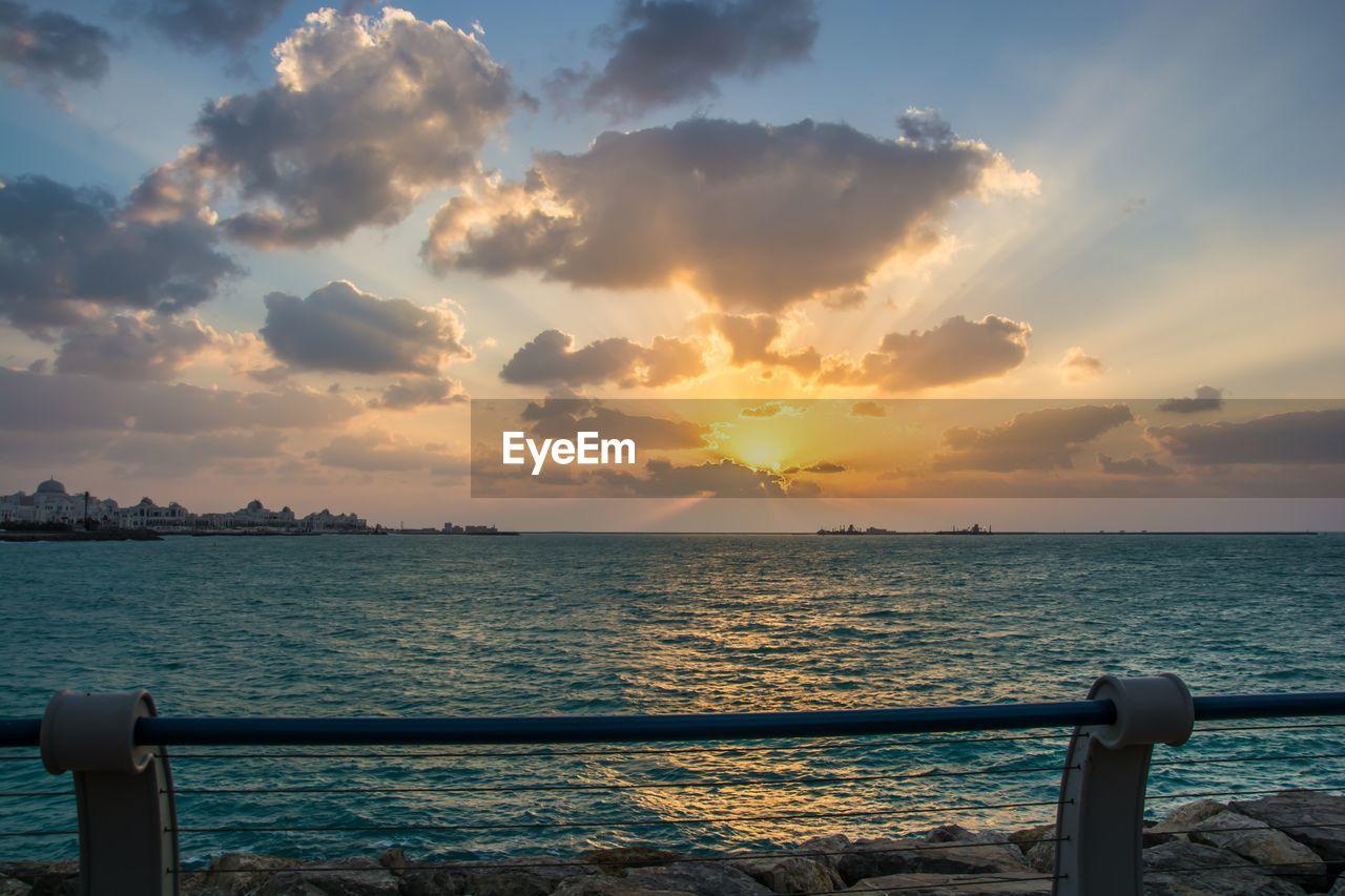 sky, sunset, water, sea, cloud - sky, scenics - nature, beauty in nature, railing, tranquil scene, nature, tranquility, no people, horizon over water, horizon, idyllic, orange color, non-urban scene, outdoors, sunlight