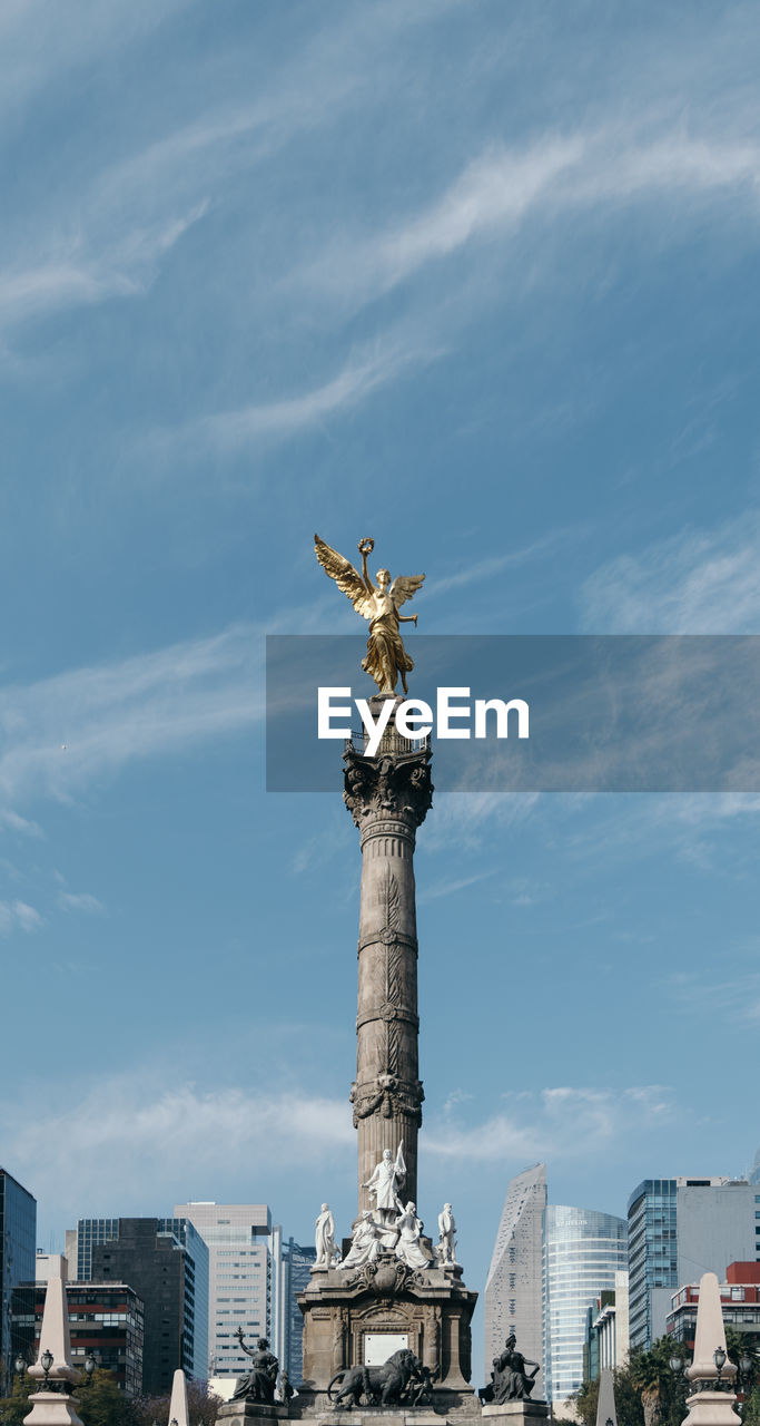 Low angle view of victory column against cloudy sky