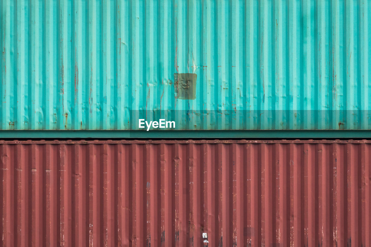 metal, pattern, iron, corrugated iron, corrugated, cargo container, full frame, day, no people, freight transportation, architecture, wall - building feature, backgrounds, built structure, outdoors, container, shipping, door, entrance, blue, iron - metal, sheet metal, turquoise colored, garage