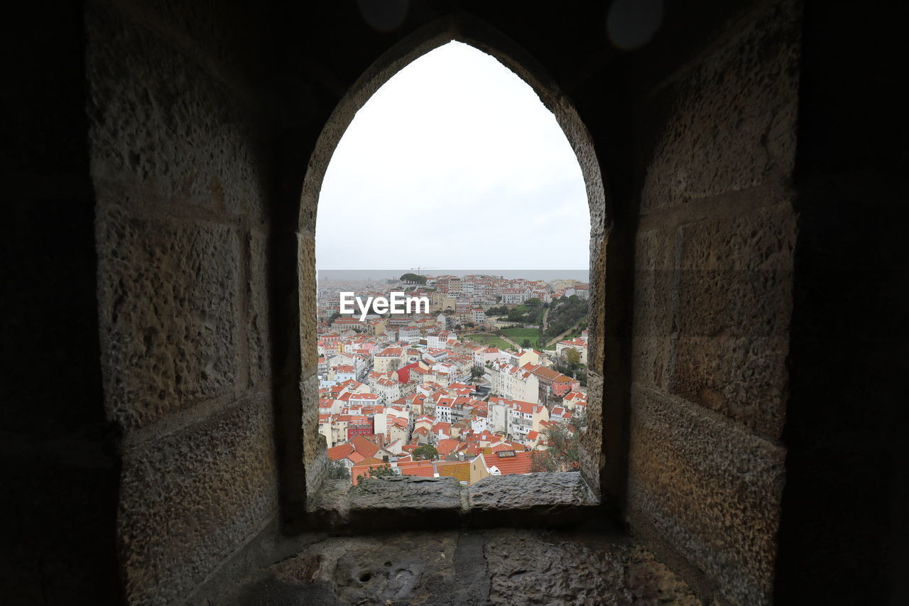 Town seen through arch window