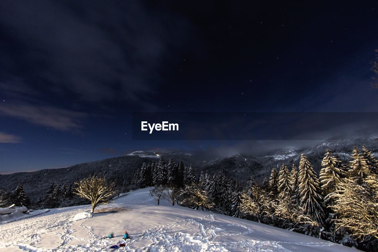 SCENIC VIEW OF MOUNTAINS AT NIGHT