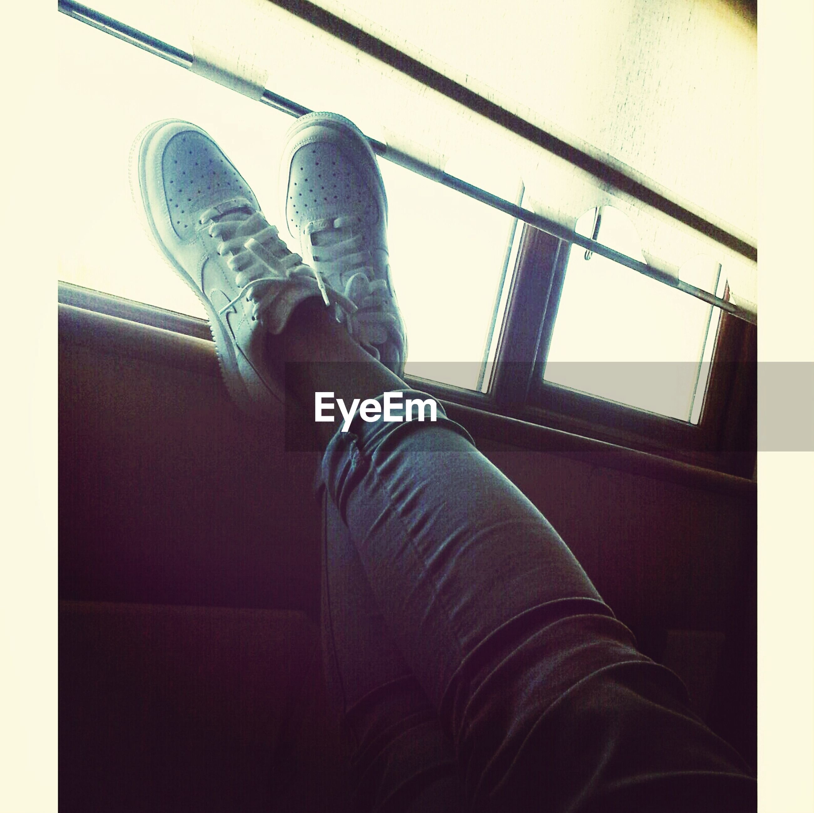 indoors, low section, person, shoe, personal perspective, men, lifestyles, low angle view, part of, standing, leisure activity, built structure, architecture, unrecognizable person, day, technology, sitting