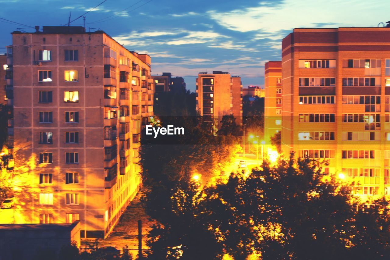 architecture, building exterior, built structure, illuminated, city, residential building, night, outdoors, no people, sky, tree, residential, cityscape