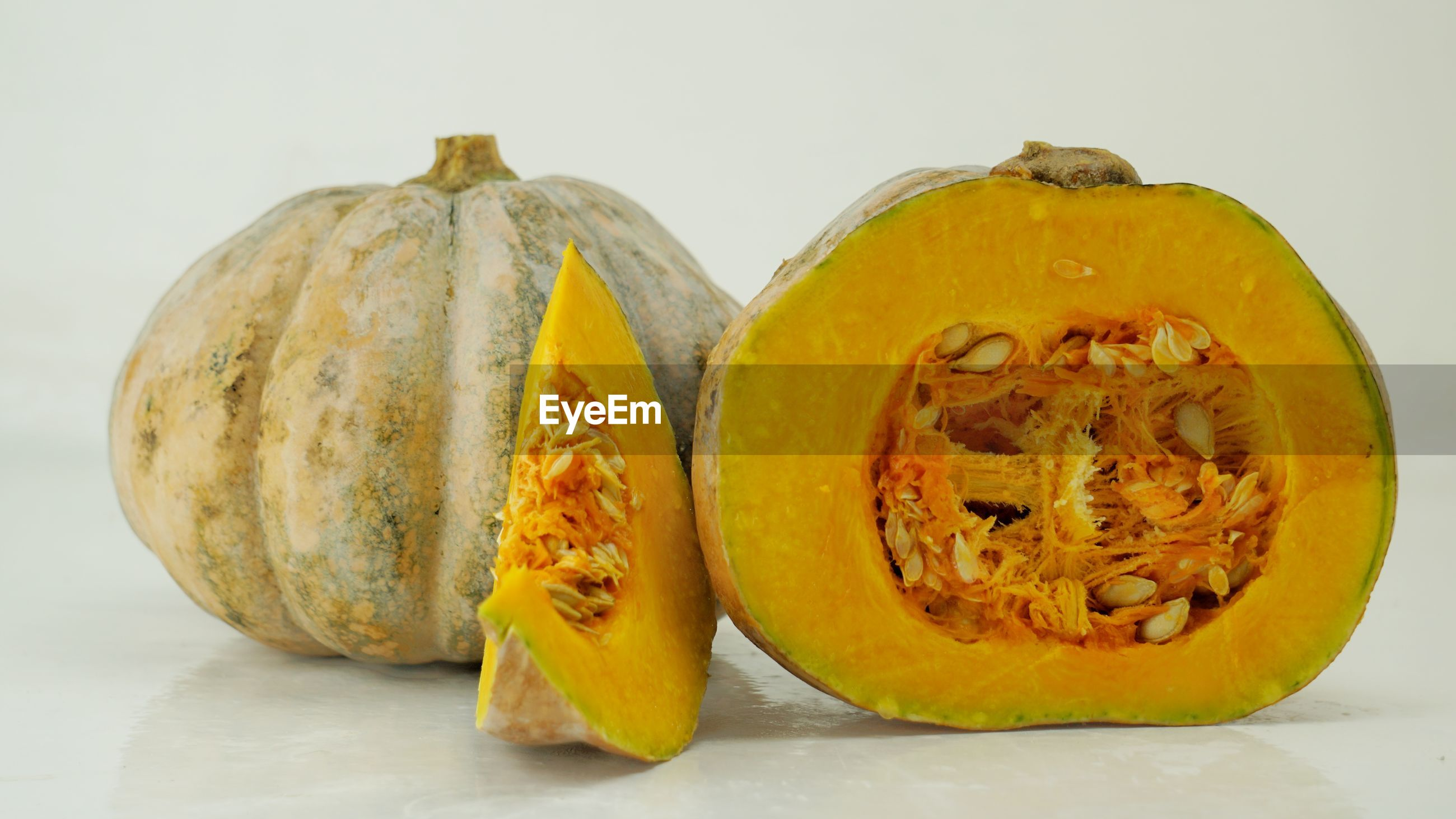 CLOSE-UP OF PUMPKIN AGAINST GRAY BACKGROUND