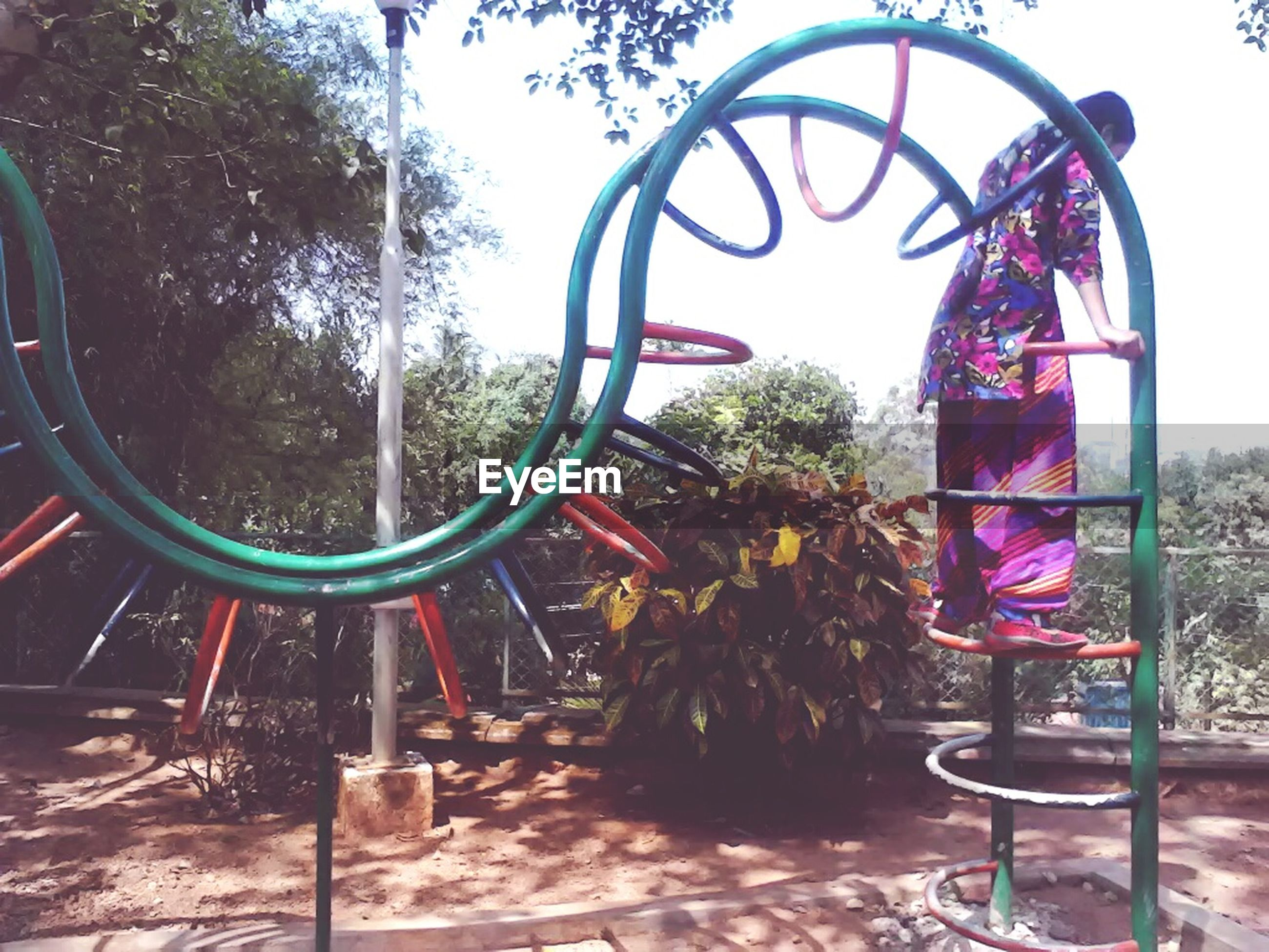 tree, outdoor play equipment, metal, playground, outdoors, day, no people, slide - play equipment, childhood, bicycle rack, nature, jungle gym, tire