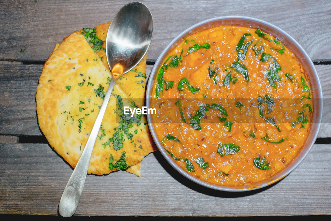 food, food and drink, freshness, healthy eating, wellbeing, directly above, ready-to-eat, wood - material, kitchen utensil, still life, table, bowl, indoors, close-up, eating utensil, spoon, no people, serving size, high angle view, orange color, garnish, herb, indian food, temptation, vegetarian food