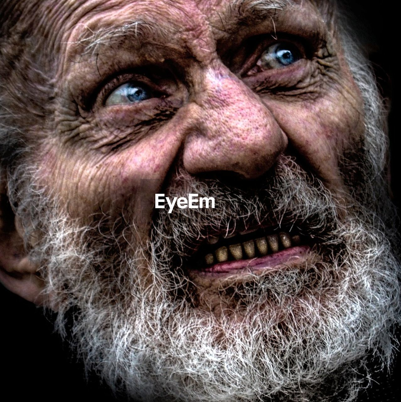 beard, portrait, looking at camera, one senior man only, one man only, senior adult, one person, mature adult, human face, adults only, gray hair, adult, headshot, only men, night, people, human body part, close-up, black background, men, human eye, halloween