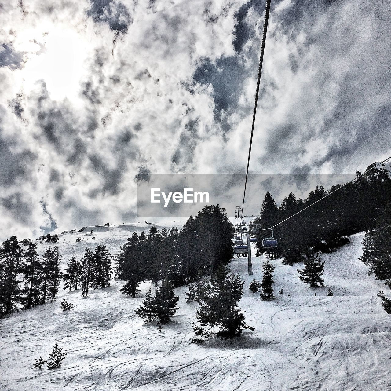Ski lift and snowcapped mountain