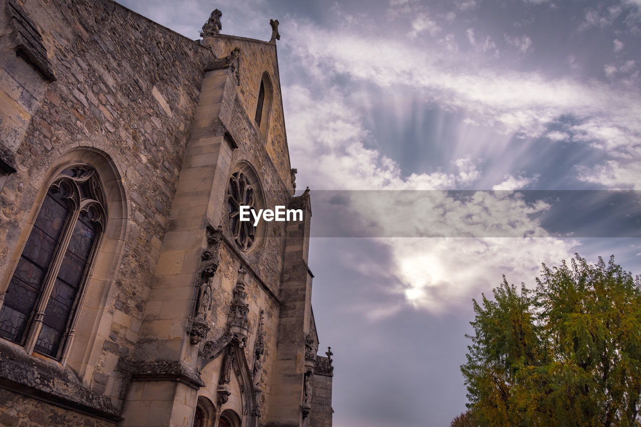 low angle view, architecture, built structure, cloud - sky, building exterior, place of worship, sky, religion, belief, spirituality, building, nature, the past, history, no people, day, tower, clock, gothic style