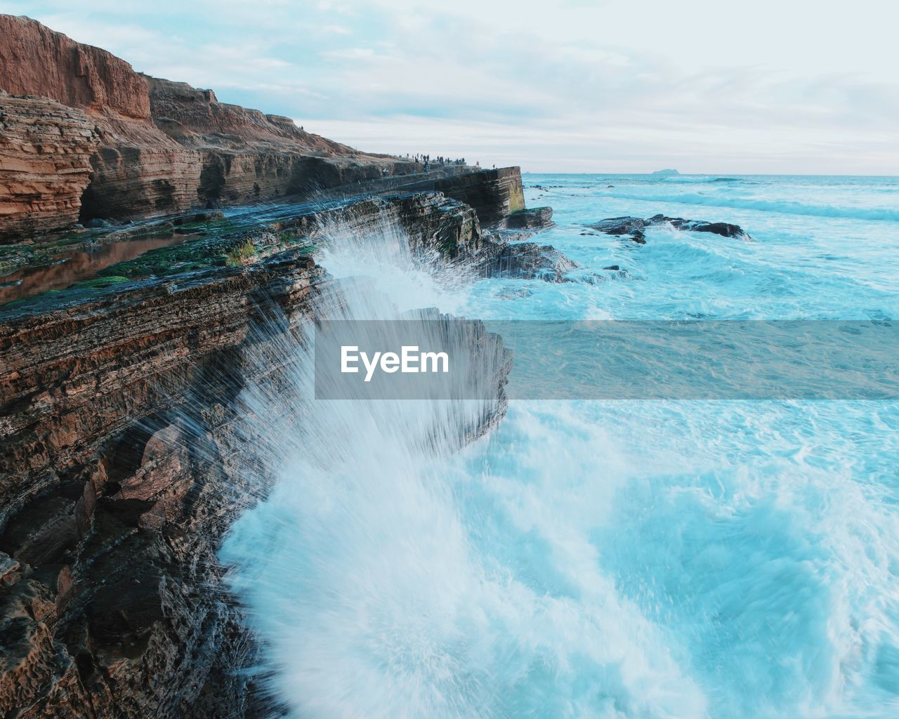 Scenic View Of Majestic Rocky Coastline