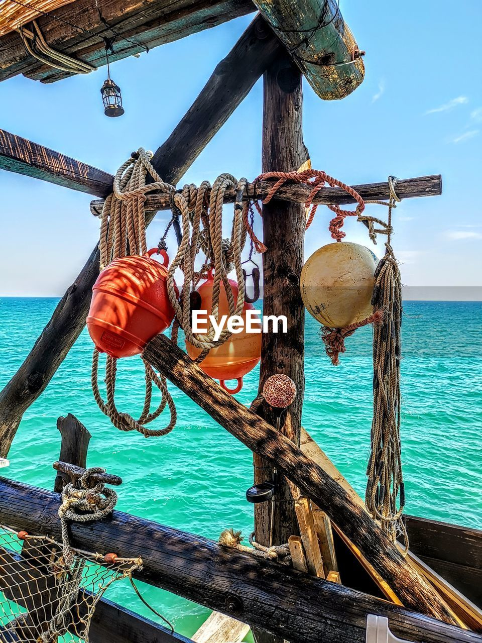 water, sea, sky, nature, wood - material, nautical vessel, day, horizon, horizon over water, transportation, rope, outdoors, no people, sunlight, beauty in nature, hanging, scenics - nature, mode of transportation, land, wooden post, fishing industry