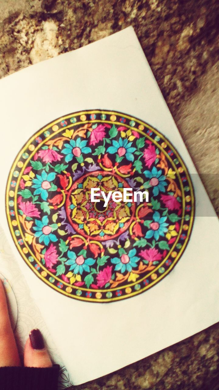 multi colored, circle, close-up, indoors, pattern, one person, day
