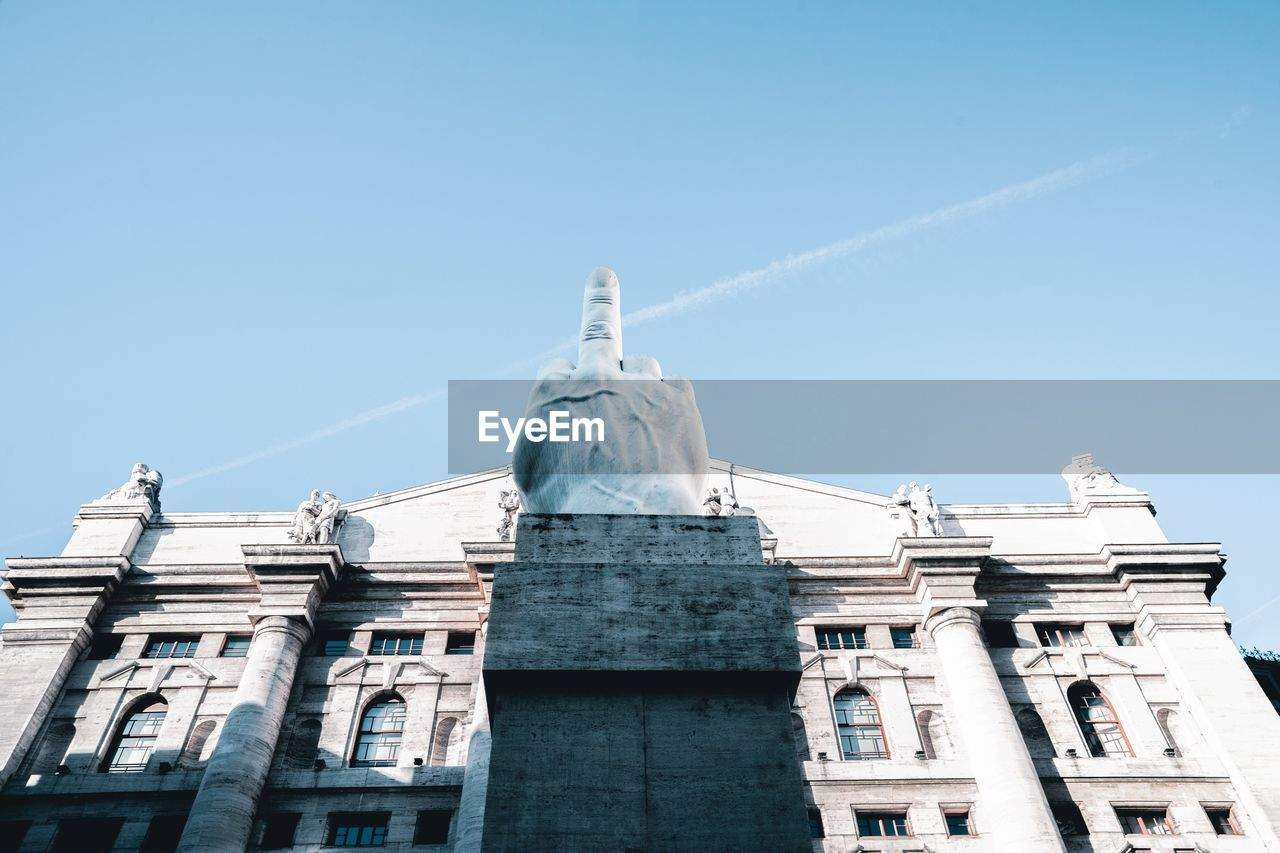 architecture, sky, built structure, building exterior, sculpture, low angle view, human representation, clear sky, statue, representation, no people, day, building, art and craft, blue, nature, creativity, male likeness, craft, history, outdoors