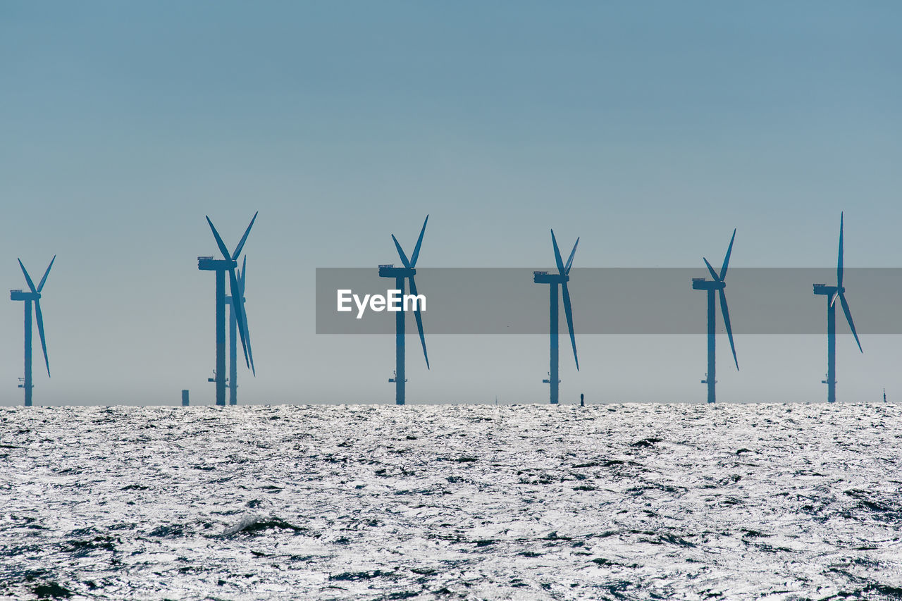 sky, fuel and power generation, environmental conservation, environment, renewable energy, wind turbine, turbine, alternative energy, wind power, nature, no people, land, technology, snow, day, scenics - nature, cold temperature, field, winter