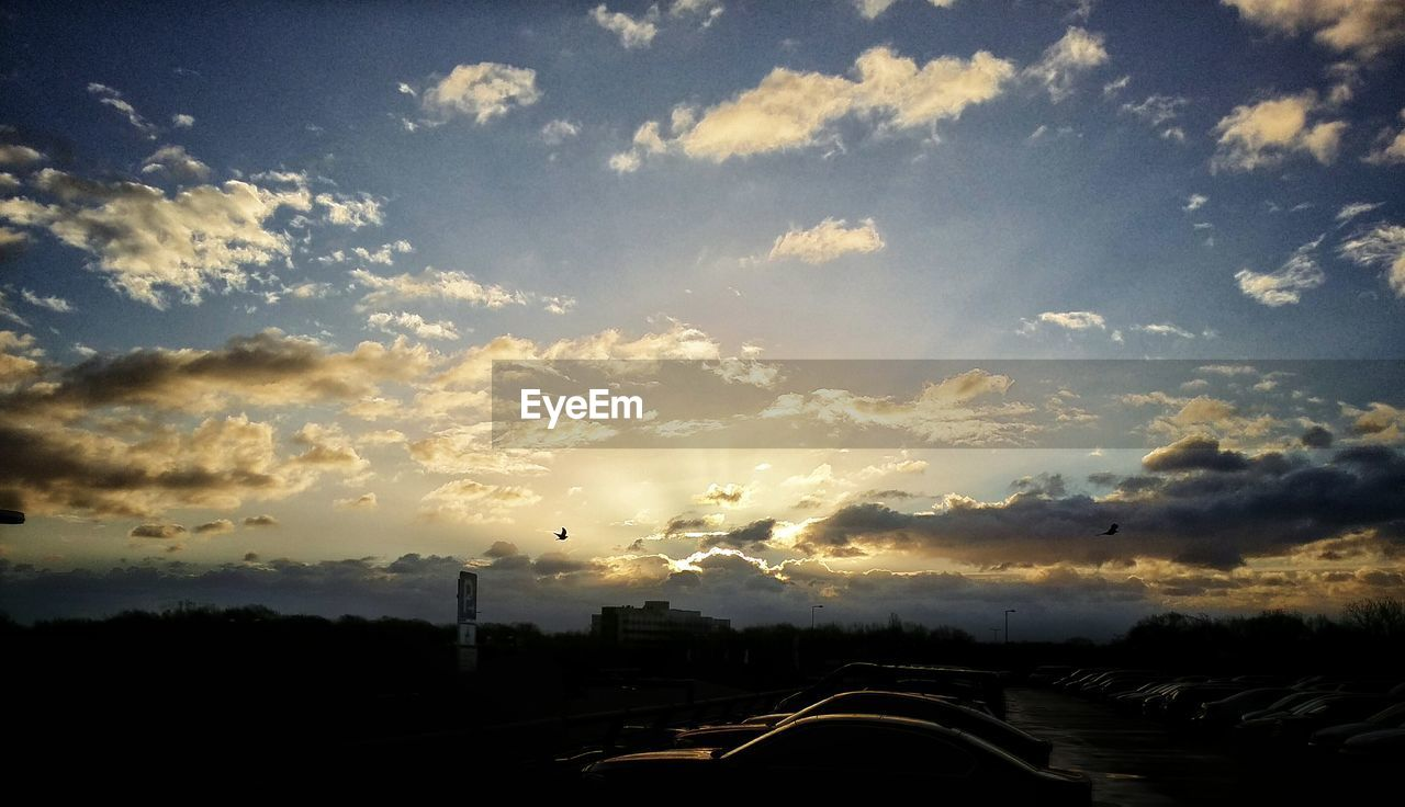 cloud - sky, sky, transportation, road, no people, car, land vehicle, sunset, nature, beauty in nature, scenics, outdoors, tree, day