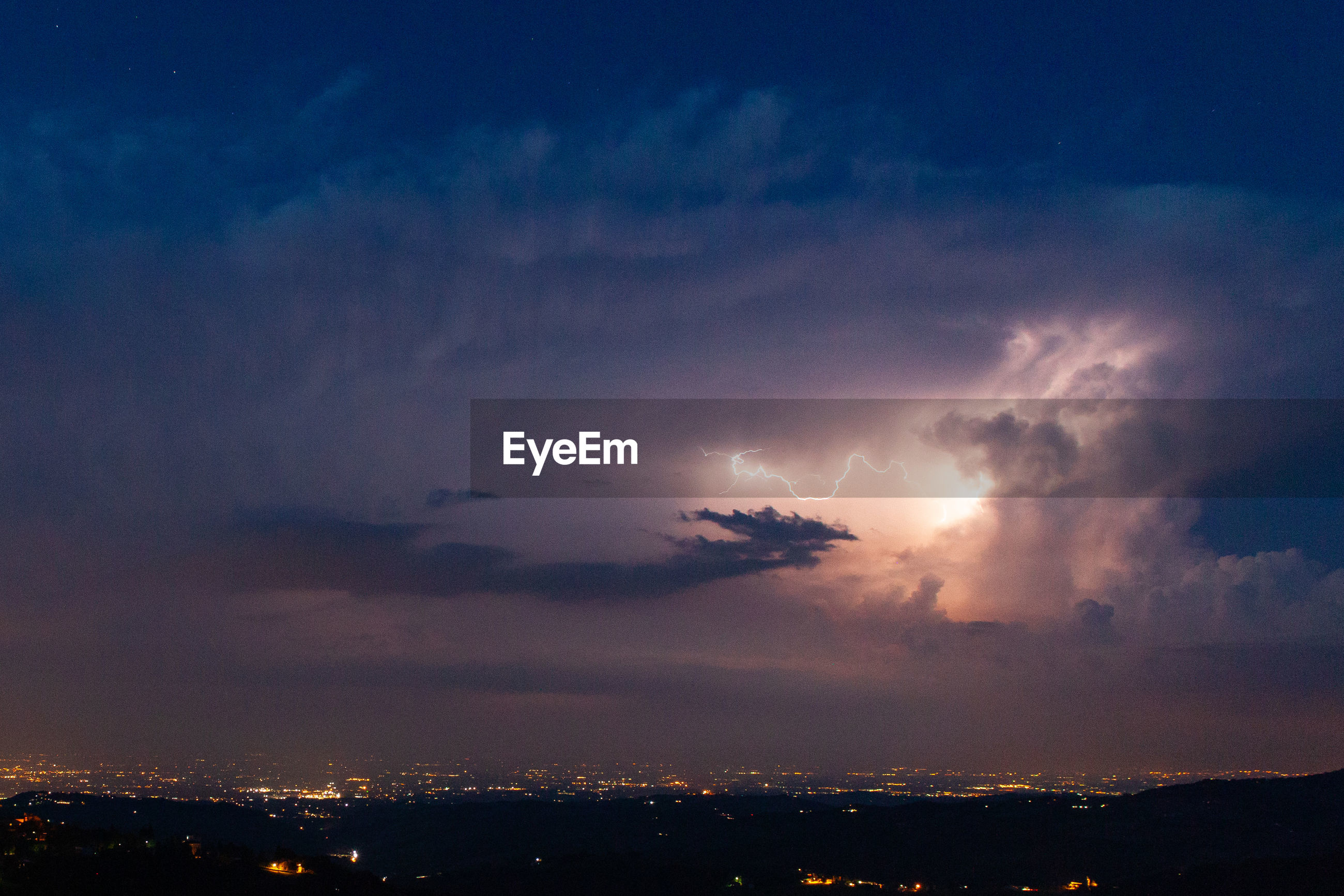 A summer night big thunderstorm on the plain around modena and bologna in italy