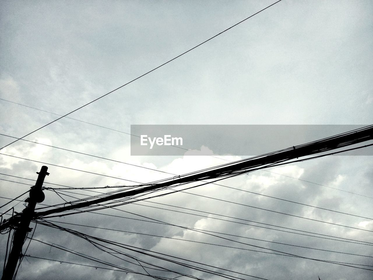 low angle view, cloud - sky, cable, sky, power line, electricity, connection, day, no people, architecture, nature, built structure, outdoors, power supply, technology, overcast, silhouette, metal, bridge, complexity