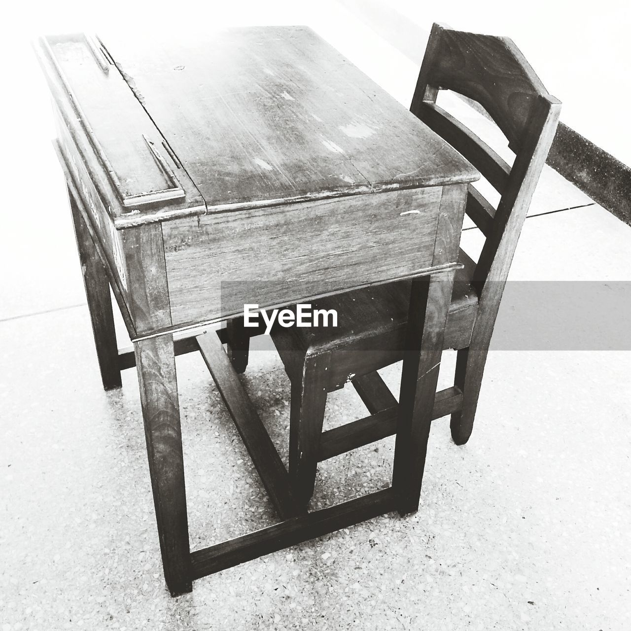 High Angle View Of Wooden Desk And Chair At School